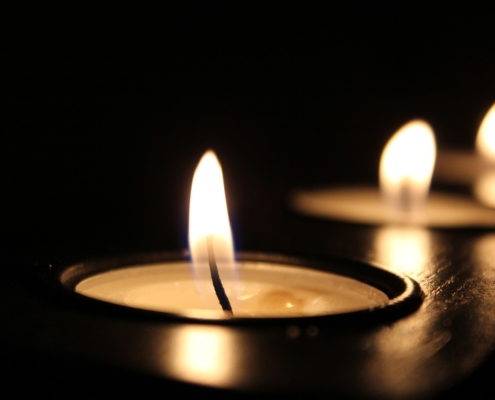 Photo of a burning tealight candle.