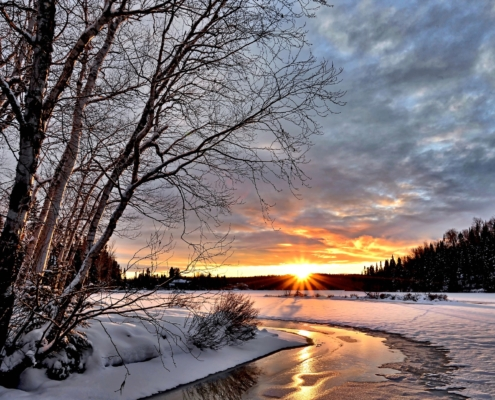 Photo of a snowy winter sunset.